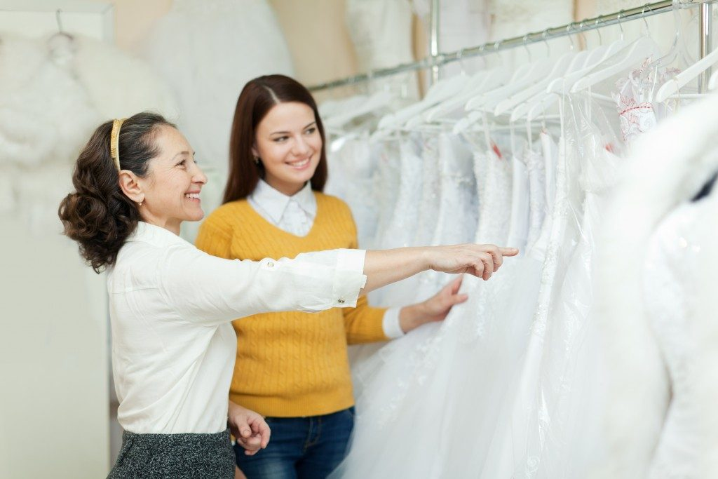 bride to be choosing her wedding gown