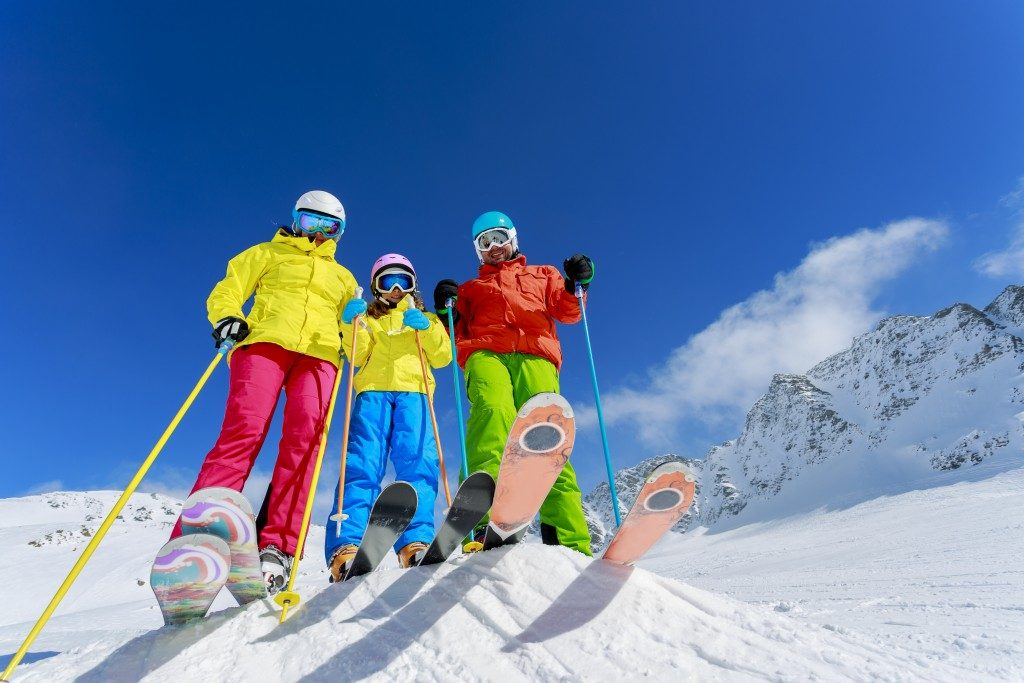 Three people skiing
