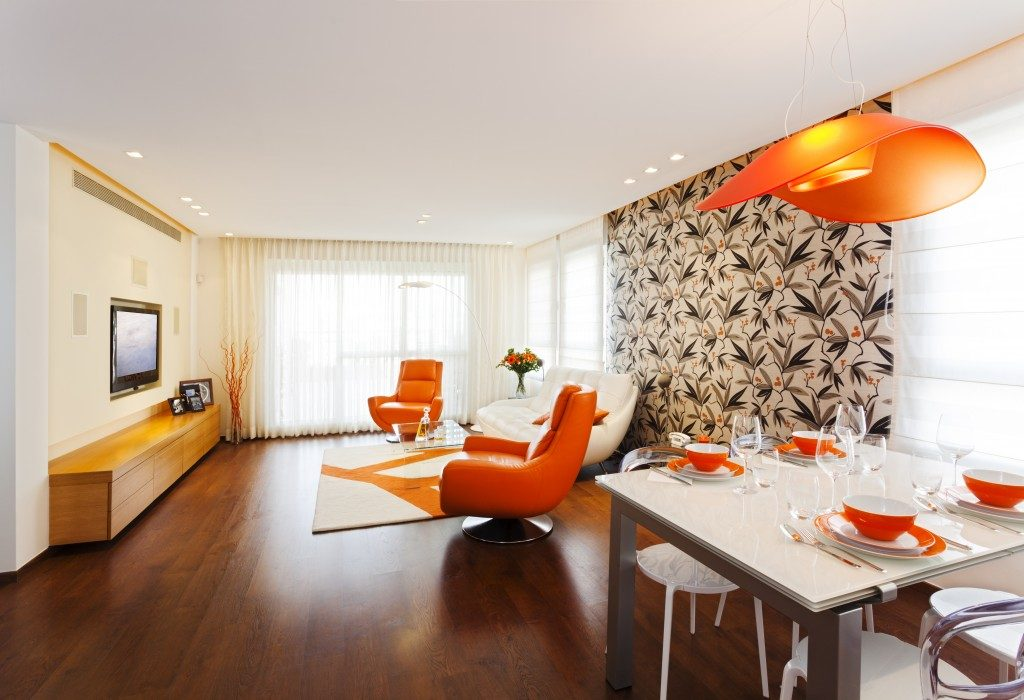 orange and white living room interior