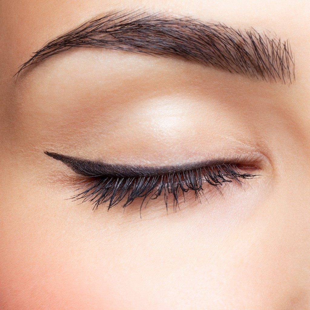 Close up of woman's eye and eyebrow makeup
