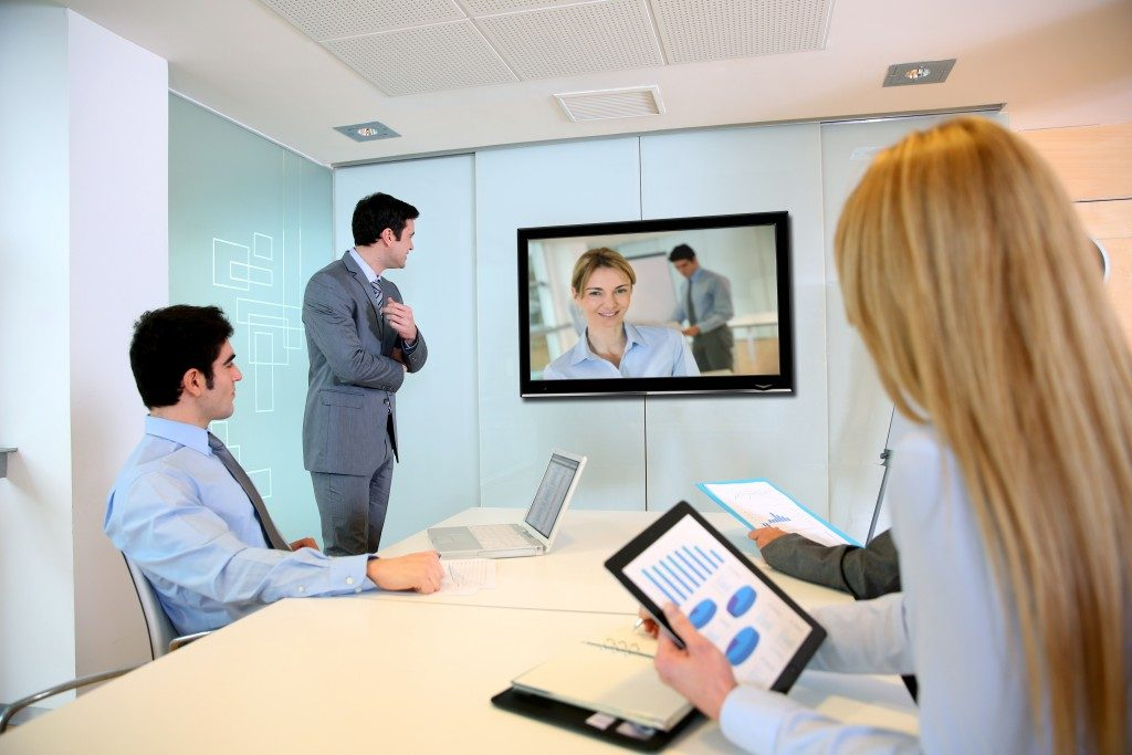 businesspeople watching a video