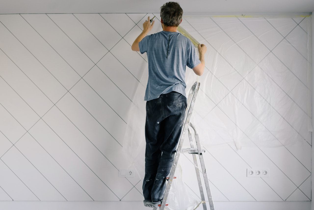 man repainting wall