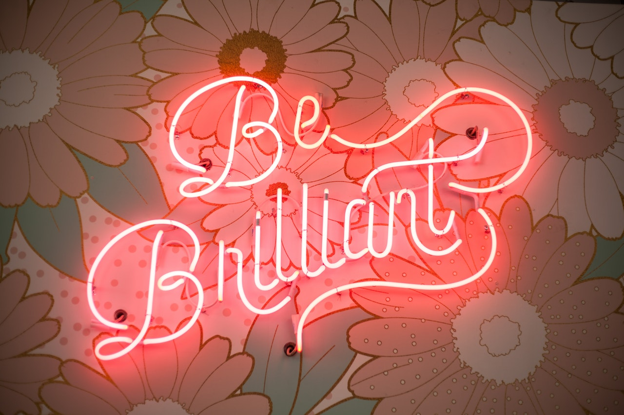 neon sign which reads be brilliant