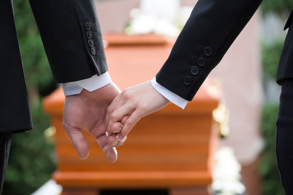 comforting each other at a funeral