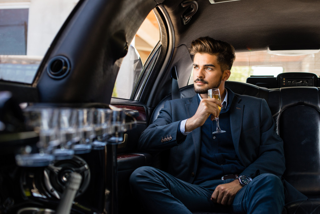man travelling by limousine